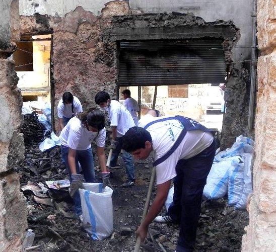 Clearing charred debris.