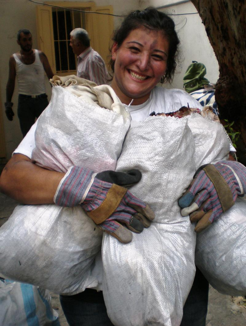 Woman clearing debri