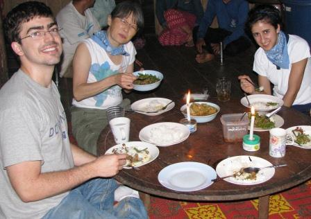 Eating in the field at a tribal home.