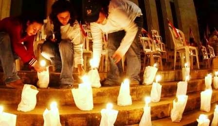 Young women lighting candles