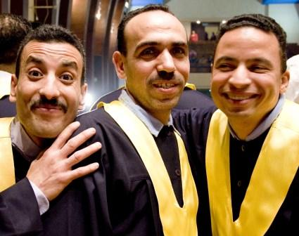 Smiling caregiver graduates.