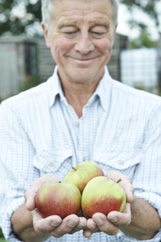 senior_holding_apples.jpg