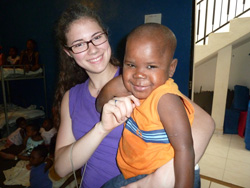 Nora With Haitian Boy