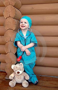 Child in scrubs