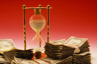 hourglass and money