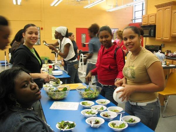 Teen Esteem girls prepare salad