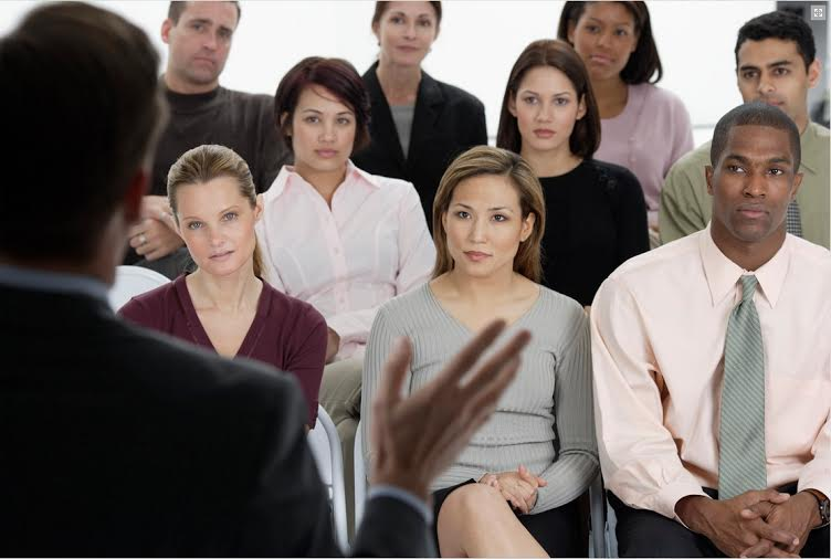 Picture of a speaker addressing an audience