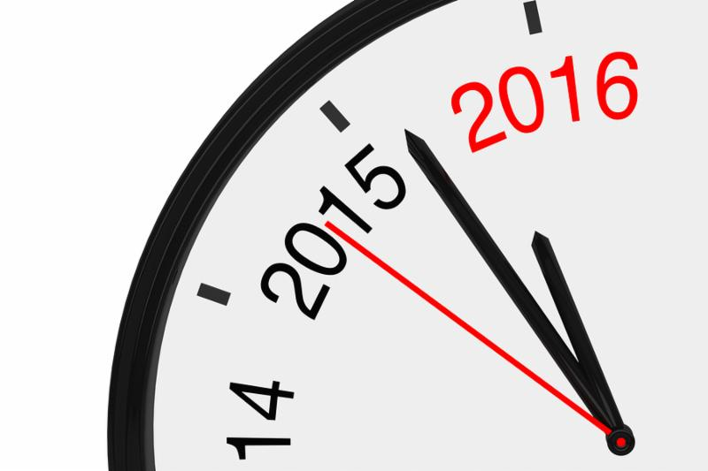 The year 2016 is approaching. 2016 sign with a clock on a white background
