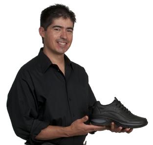 Andres Gallegos holding a Bio-Trek shoe