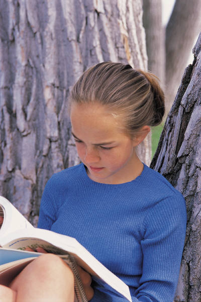 Girl reading in tree