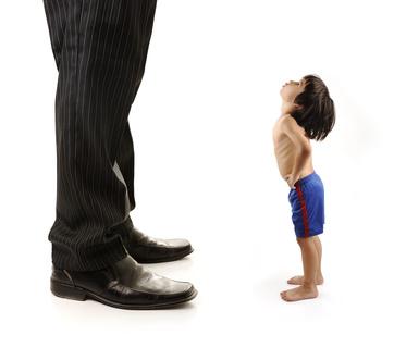 Small boy looking at big man