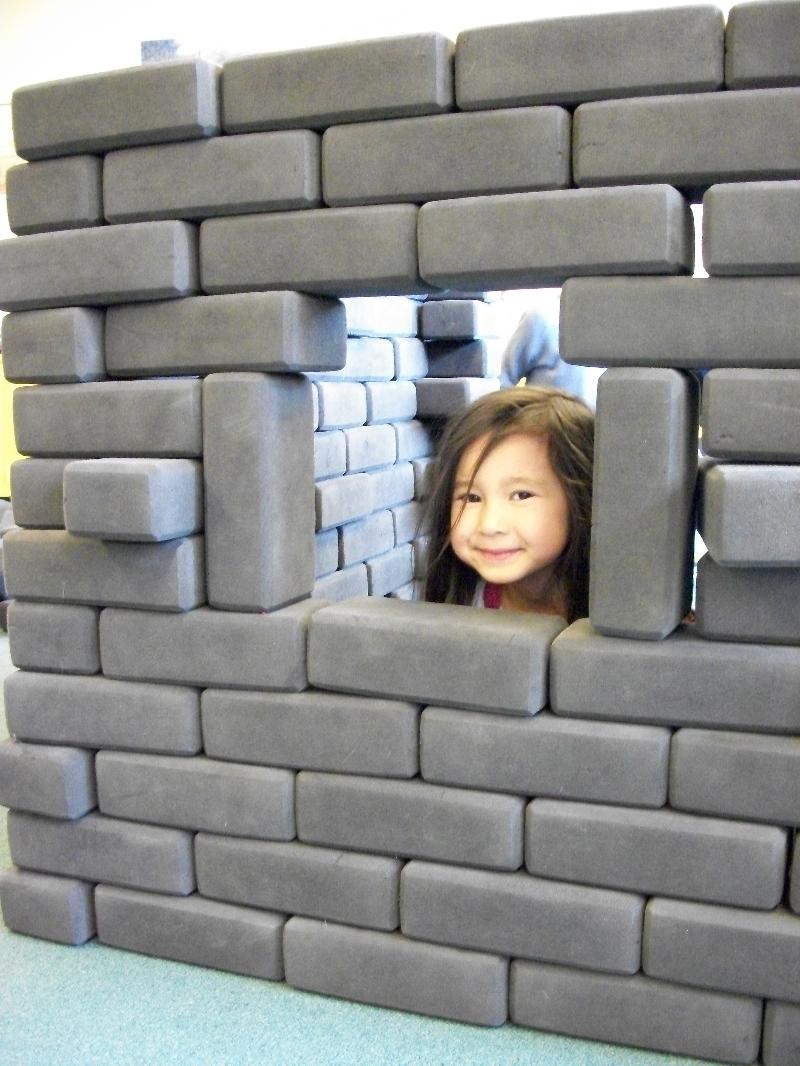 girl looking through block window