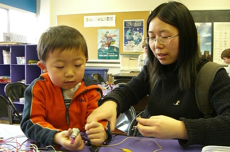 mom and boy with circuits