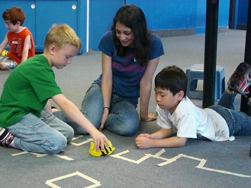 kids playing with bee bots