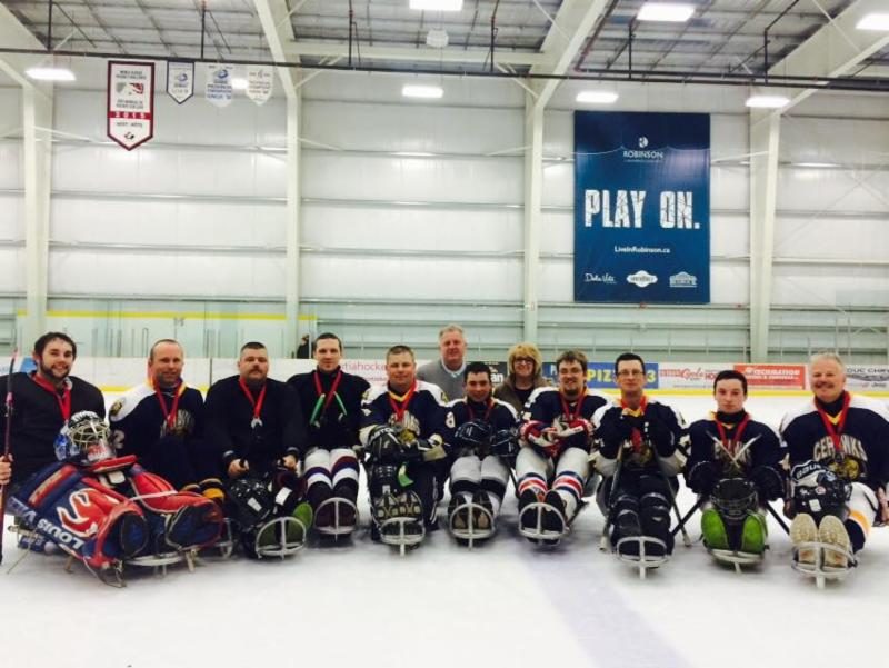Gold and silver medalists at the Matt Cook Memorial Sledge Hockey Tournament