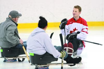 Derek Whitson teaching the rules for sledge hockey at the Family Leisure Centre in Medicine Hat