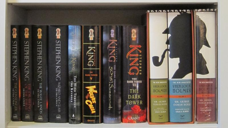 Custom bookcase with clients' Sherlock Holmes and Stephen King books.