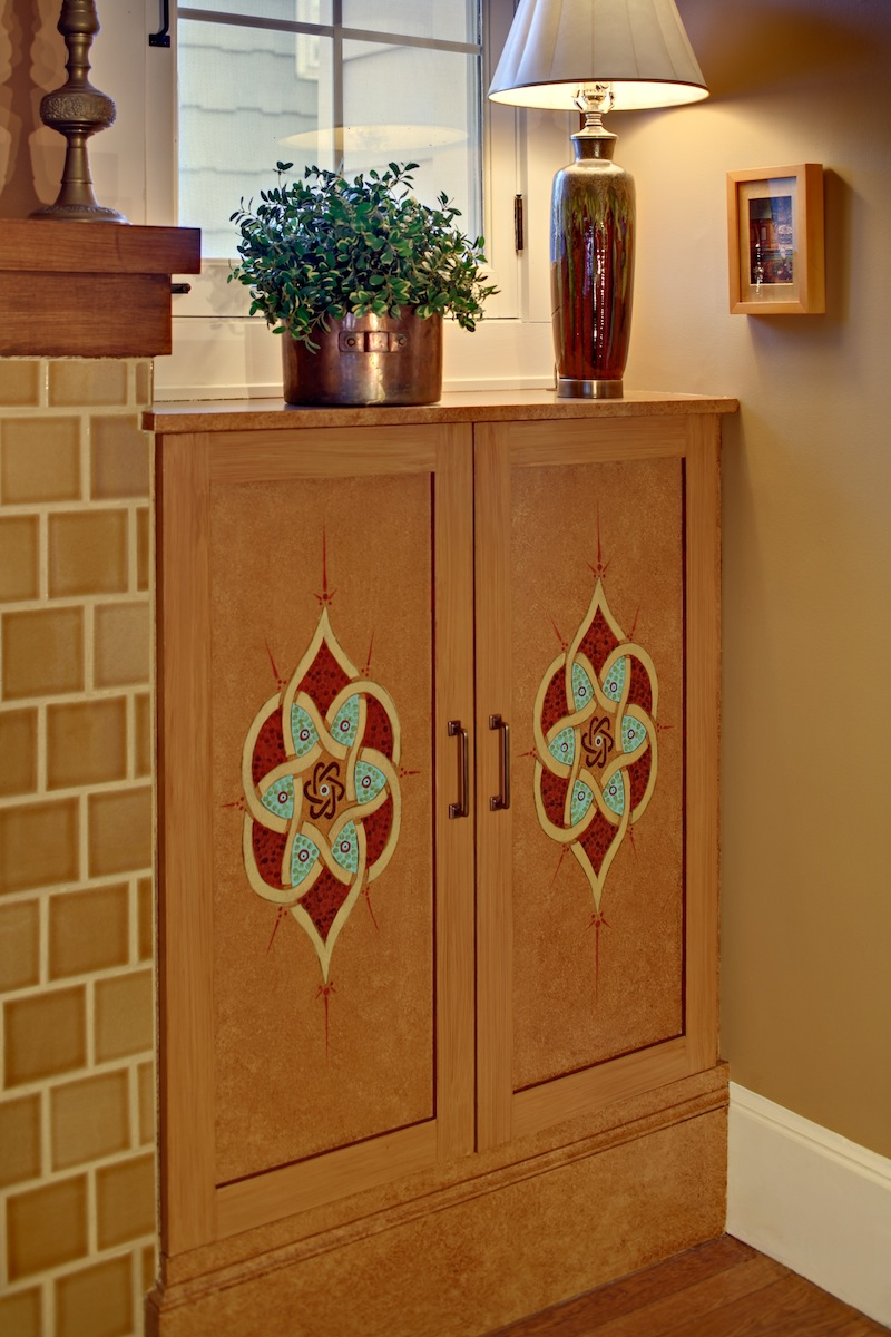 Custom cabinet glazed and stenciled with an Islamic 7 circle design.