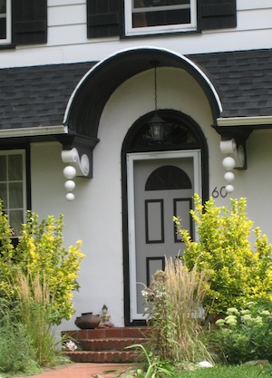 front door with arch and cool brackets