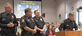 Police officers at Board meeting