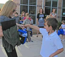 Student giving teacher a welcome goodie bag