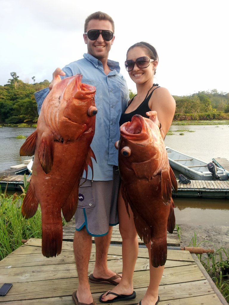 Two big grouper and two happy guests