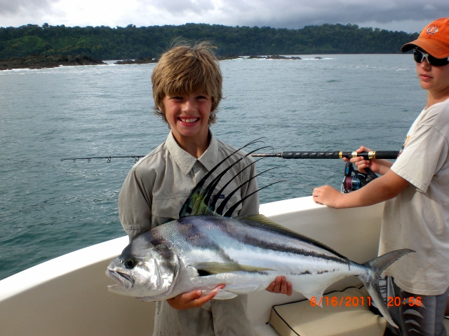 A kid catches a roosterfish near Drake Bay Costa Rica