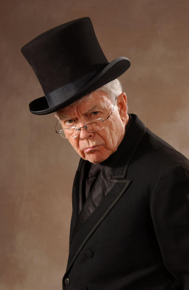 Fred Adams as Scrooge