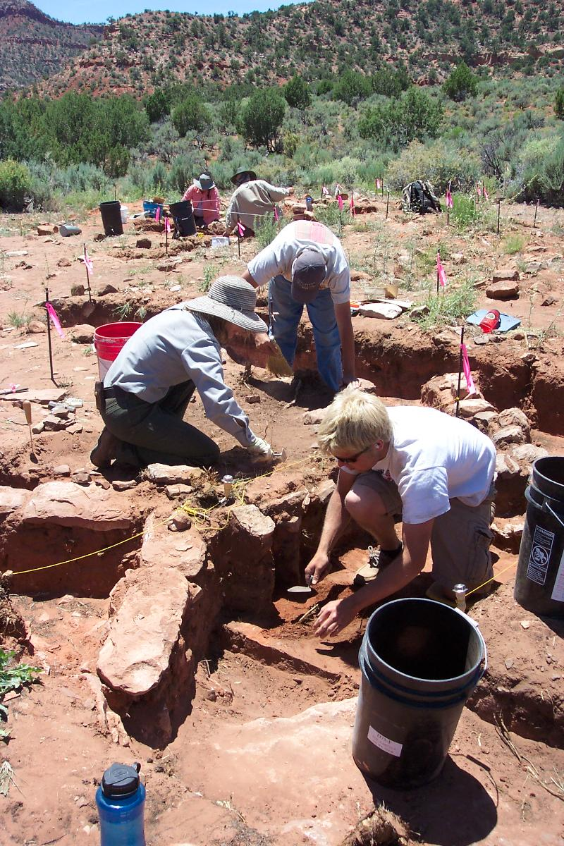 Ian Wright (foreground) of Salt Lake City and a 2010 graduate and a student in the Archeology Field School, works with Claire Crow (left) and Dan Rhode of Zion National Park to uncover and preserve the Pueblo II site outside of Kanab, Utah.