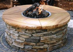 Cultured stone firepit by Stone Garden