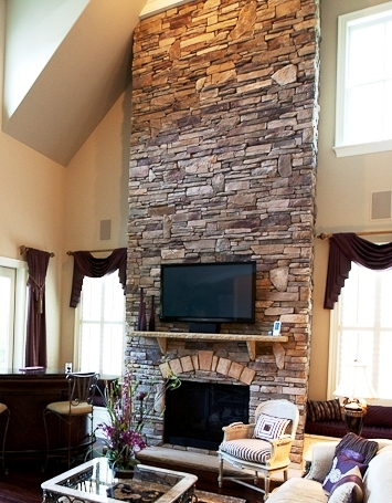Fireplace by Herrington Classic Homes and Stone Garden