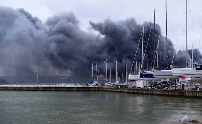 Smoke from the Medina Village fire billows across the harbour
