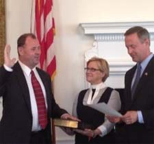 Secretary Gill sworn in by Governor O'Malley.