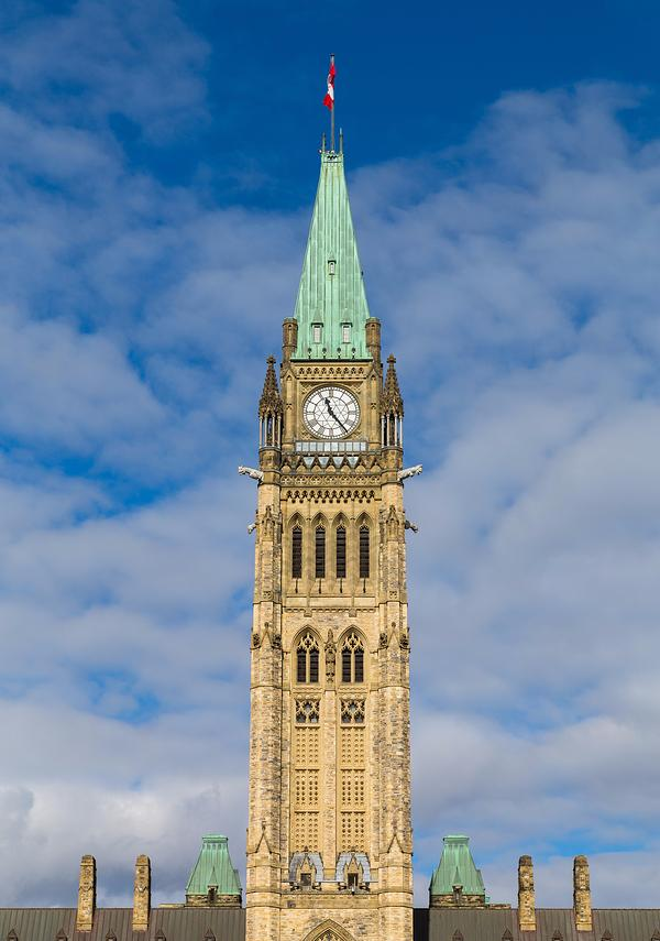 Closeup to the Ottawa Parliament Clock Tower in Canada during the day