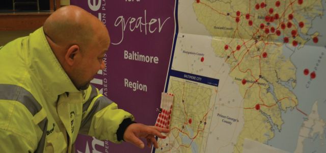 Man looking at map of ideas at Maximize2040 outreach event