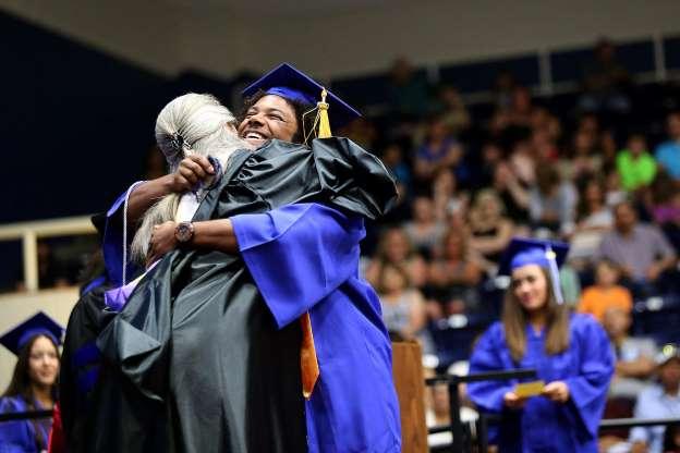 Auntravion Dominique Ellis hugs Valerie Jones, vice president of instruction at Odessa College commencement