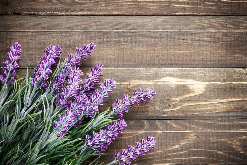 Lavender flowers on a vintage wooden background