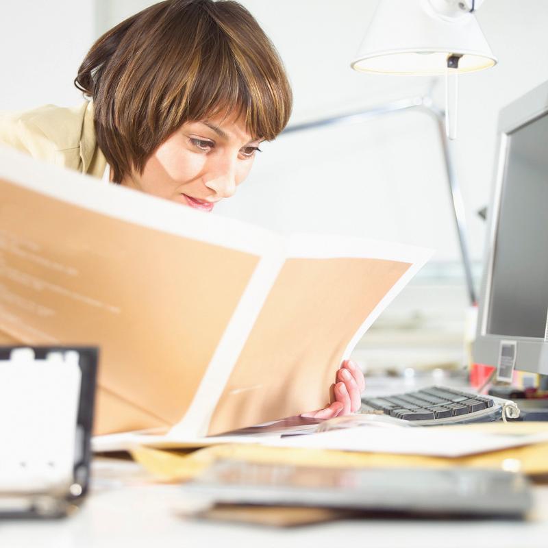 Business Woman Reading Handbook