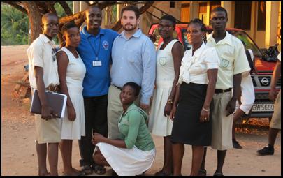 Joel Inglis with youth savings club members in Ghana