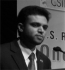 Rashad Hussain in bw