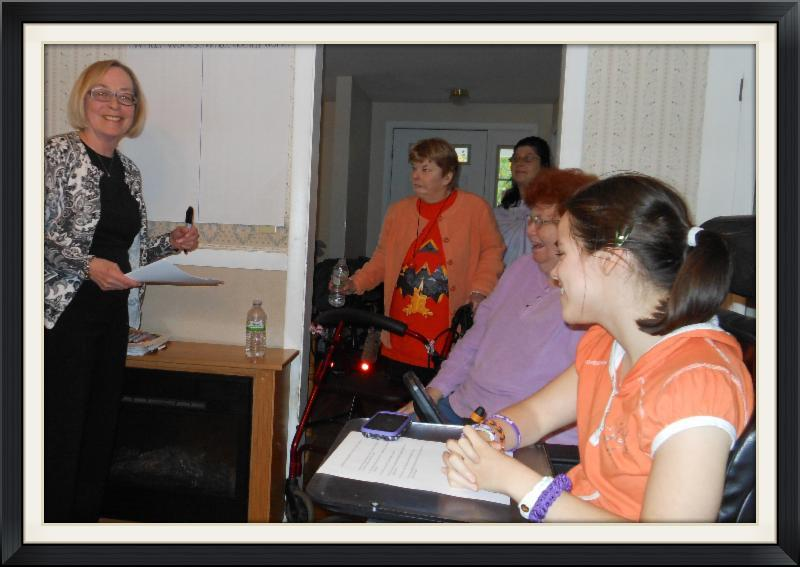 Janelle participates in Person Centered Planning in her home