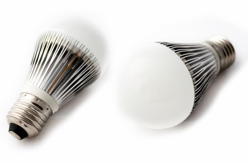 Close-up of two LED light bulbs against a white background.