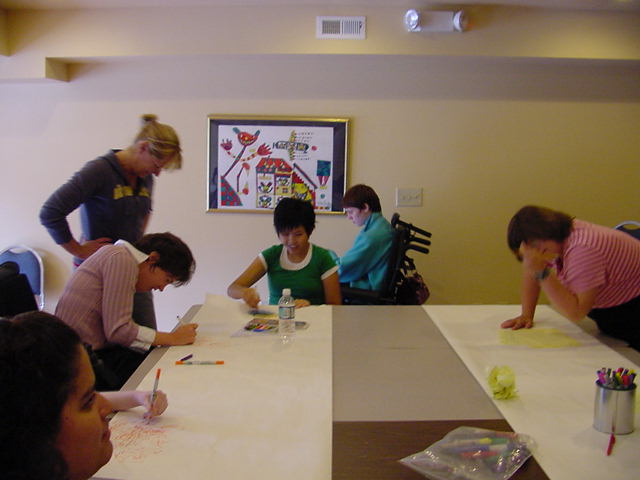 Youth Self Advocates working on signs for the Food Drive