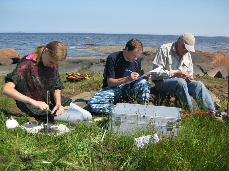 Students conducting sampling and monitoring activities