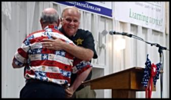 Bob Proud and Sheriff Rodenberg hug. County Fair 2016