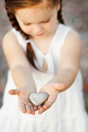 little girl with heart rock