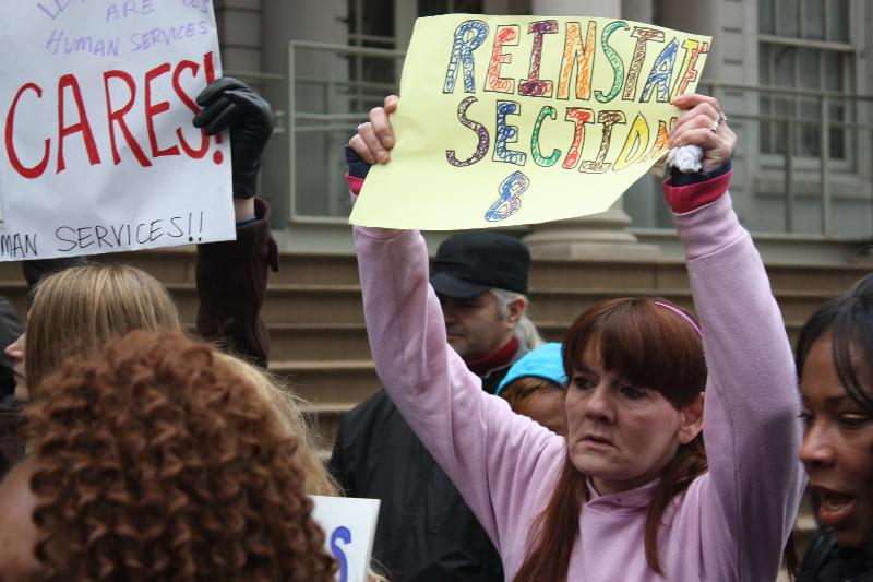 woman with sign at rally