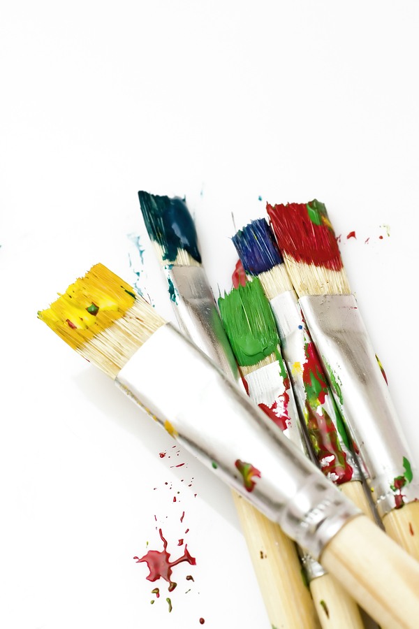 used paint brushes of different colors
