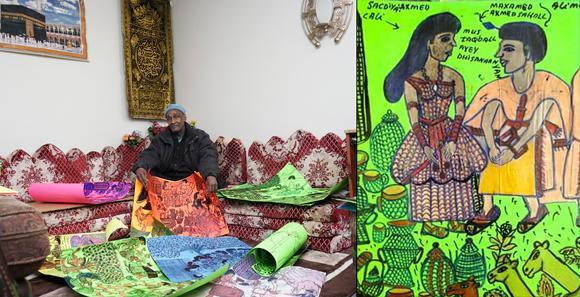 Hassan Nor in his home with his drawings