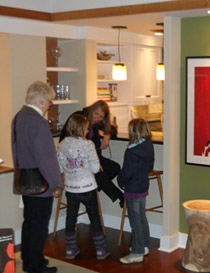 Sarah chats with young showhouse visitors
